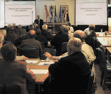 The Veterans Ombudsman, Guy Parent, hosts a town hall in Quebec City in 2011.