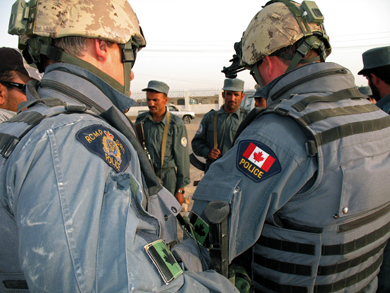 Royal Canadian Mounted Police along with Military Police from 1 MP Platoon serving at the Canadian Forces Provincial Reconstruction Team site in Kandahar, Afghanistan
