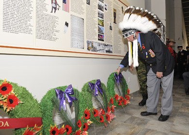 Chief Lawrence Paul, Millbrook First Nation (Truro), Nova Scotia lays a wreath during a Remembrance Ritual after an unveiling ceremony of a Mi'kmaq Veteran Wall of Honour at the Glooscap Heritage Centre, Millbrook First Nation
