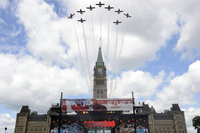 The Canadian Forces Snowbirds Demonstration Team conducts a fly-past above Parliament Hill as part of Canada Day celebrations in Ottawa.